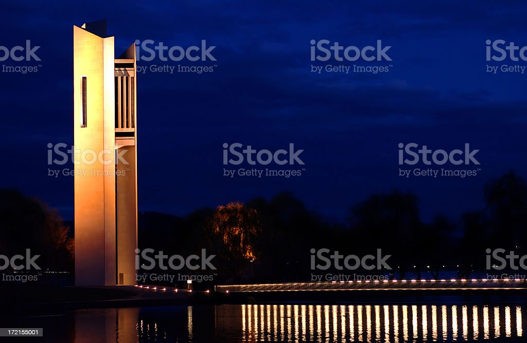 Carillon lit up at night under brilliant blue sky stock photo