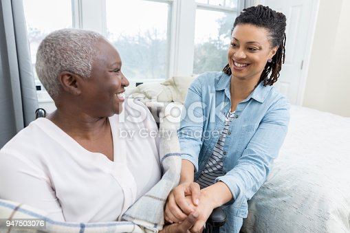 932074776istockphoto Caring adult daughter comforts her aging mother 947503076