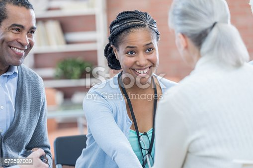 487670635istockphoto Caring counselor comforts patient during therapy session 672597030