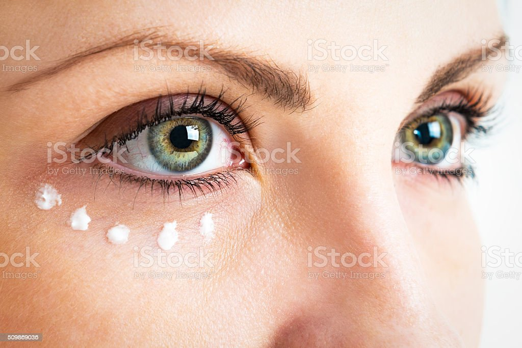 Caring for the skin around the eyes stock photo