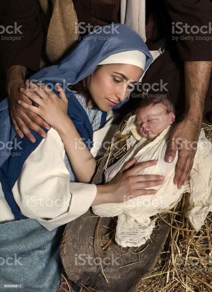 Caring hands at Christmas nativity stock photo