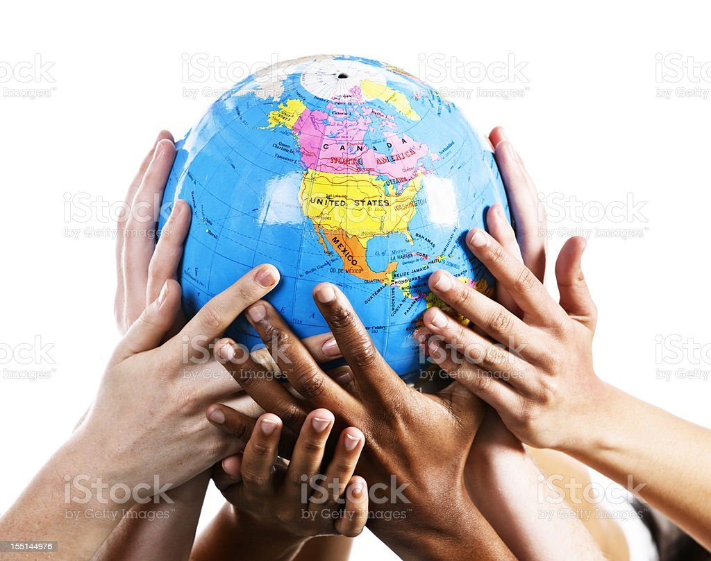 Caring hands cradle a world globe showing Northern Hemisphere royalty-free stock photo
