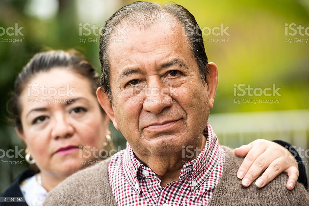 Caring, hispanic nurse and elderly senior patient in nursing home stock photo