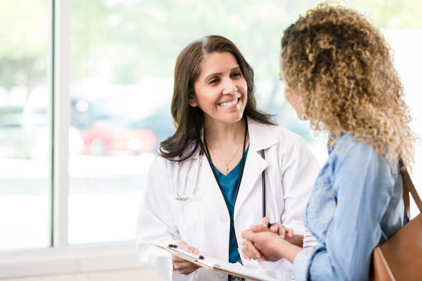 Caring mature female doctor stock photo