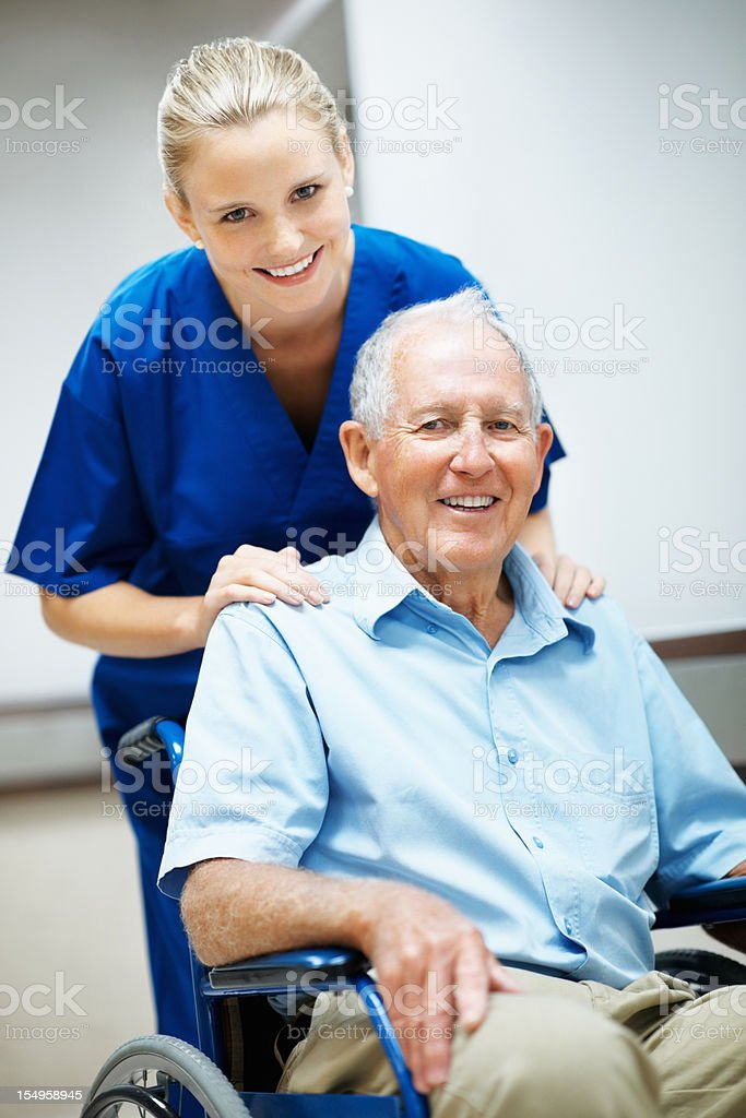 Caring nurse with a disabled senior man royalty-free stock photo