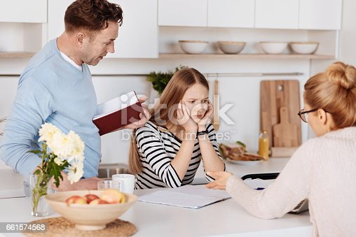istock Caring parents helping their daughter 661574568