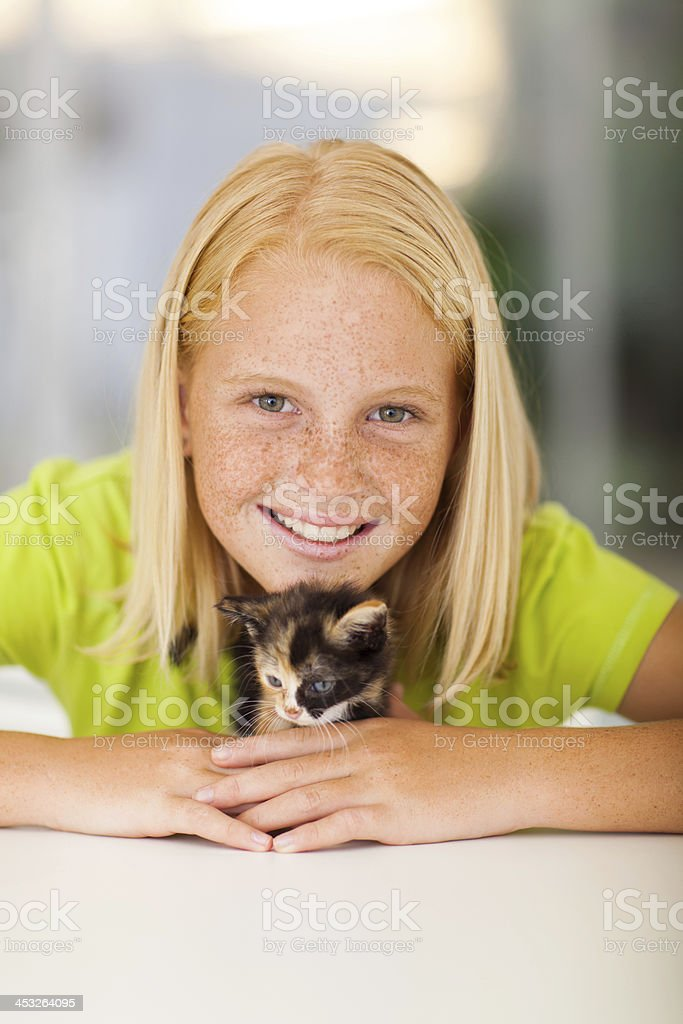 Caring Teen Girl And Pet Kitten Royalty Free Stock Photo