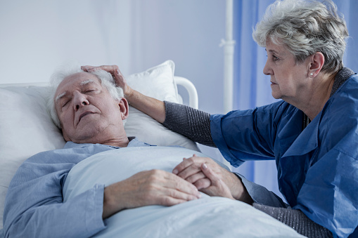 902077950 istock photo Caring wife comforting elderly husband 915318530