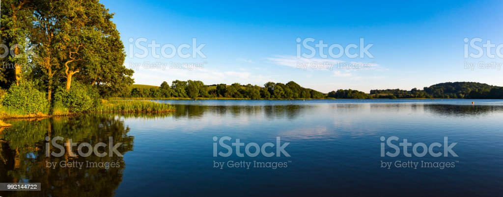 Carlingwark Loch in the early evening of a summers day stock photo