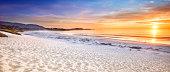 Sand beach panorama by the Pacific Ocean coastline in Carmel California near Monterey