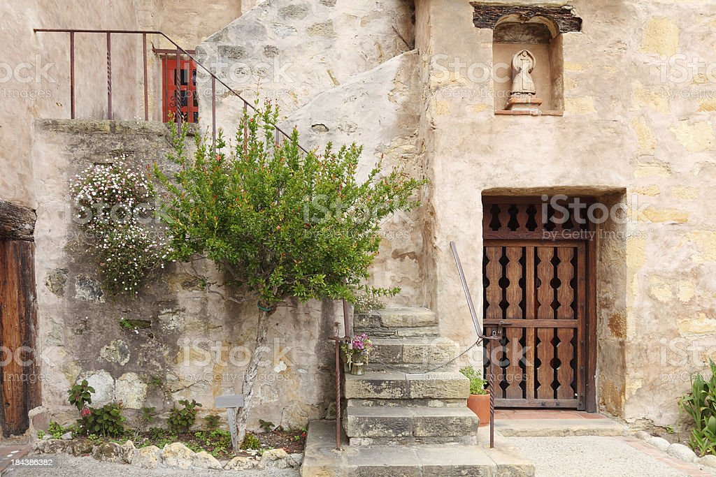 Carmel Mission stairs with bunch of flowers royalty-free stock photo