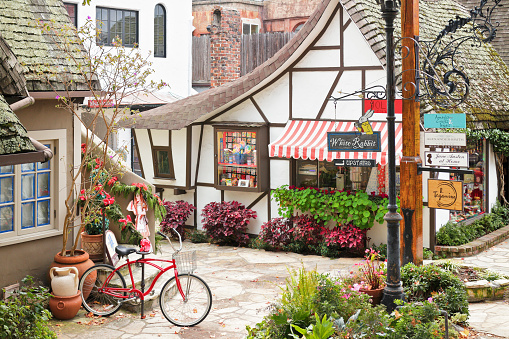 Carmel by the Sea, USA - January 2, 2016: A streetscape in Carmel-by-the-Sea featuring a retail shop housed in a typical  fairytale cottage - style architecture. Carmel located on the Monterey Peninsula was founded in 1902 and is known for its natural scenery and artistic history.