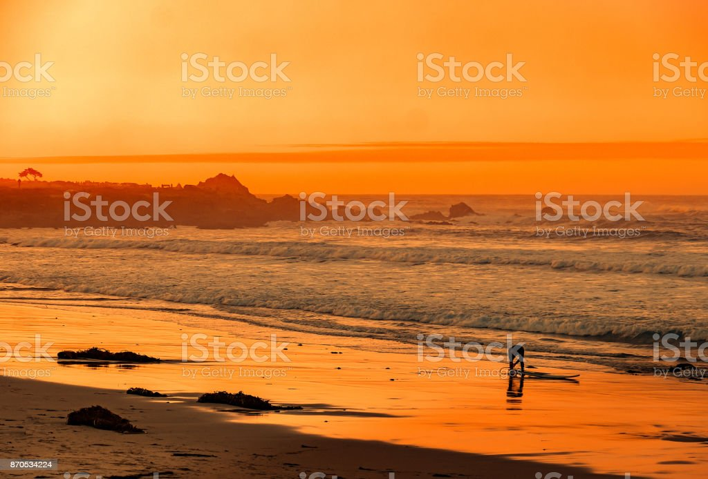 Carmel Sunset and Surfer stock photo