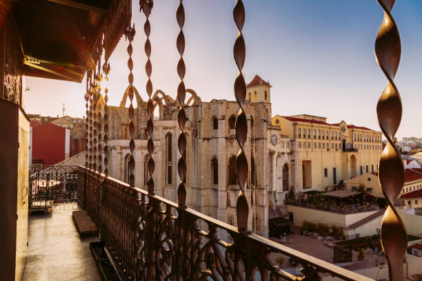 Carmo Convent building during susnet seen from Santa Justa Lift in Lisbon, Portugal stock photo