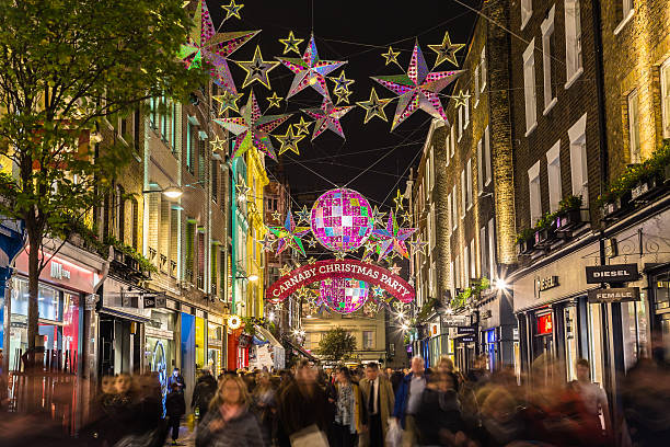 Carnaby Street at Christmas London, UK - November 27, 2015: Lights down Carnaby Street in London during the Christmas Season. Large amounts of people can be seen. carnaby street stock pictures, royalty-free photos & images