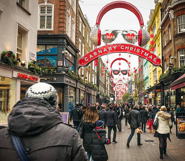 Carnaby Street at Christmas Carnaby Street in Soho, London, busy with Christmas shoppers. carnaby street stock pictures, royalty-free photos & images