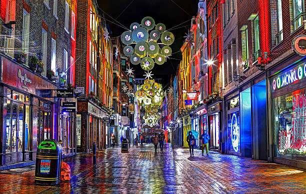 Carnaby Street at Night at Christmas London, United Kingdom - December 24th, 2012: this is an HDR long exposure taken on Christmas Eve in Carnaby Street. It captures the festive decorations of the Christmas season and several late night tourists exploring the city.  carnaby street stock pictures, royalty-free photos & images