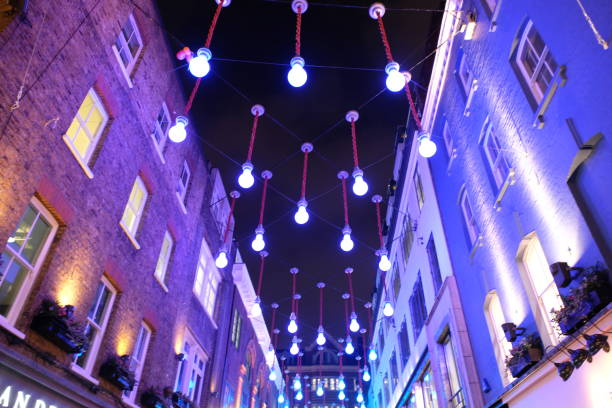 Carnaby Street lights at Christmas, London London, UK - November 22, 2018: Christmas lights decoration at Carnaby street. Shopping street in London. carnaby street stock pictures, royalty-free photos & images