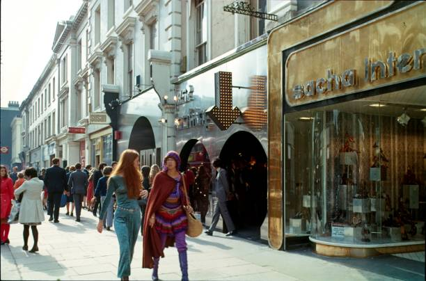Carnaby Street, London, 1973 London, Engalnd, UK, 1973. The famous London Carnaby Street with its fashion shops and bodiques. Carnaby Street was the first pedestrian zone in a European capital. Carnaby Street was popular because of its avangardist fashion, especially among young people in the 70s. carnaby street stock pictures, royalty-free photos & images