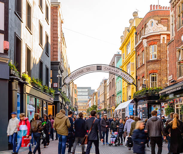Carnaby Street, London, busy full of shoppers London, England - October 26, 2015: London's Carnaby Street looking very busy full of shoppers and tourists. carnaby street stock pictures, royalty-free photos & images