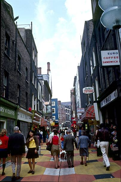 Carnaby Street, London London, England, United Kingdom, May 20, 1971. The Carnaby Street on a busy day. One of the first pedestrian zones in London and a famous fashion shopping mile in the time of Swinging London. carnaby street stock pictures, royalty-free photos & images