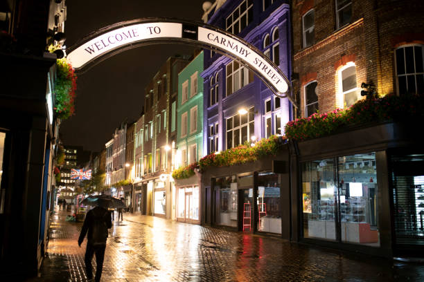 Carnaby street Carnaby street,London after rain by night carnaby street stock pictures, royalty-free photos & images