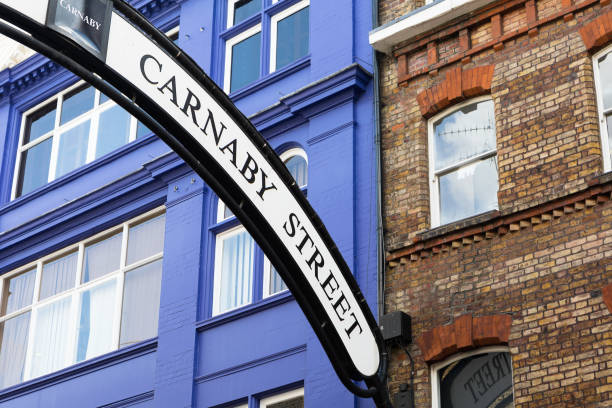 Carnaby Street Sign in London. London, UK - Sept 12, 2017: Carnaby Street sign in London, UK. Carnaby Street is an iconic pedestrianised shopping street associated with swinging London of the 1960s. carnaby street stock pictures, royalty-free photos & images