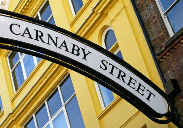 Carnaby Street sign with a yellow building in the background Colourful Carnaby Street. Made famous in the sixties. carnaby street stock pictures, royalty-free photos & images