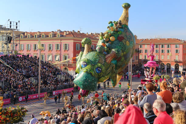 Carnaval de Nice, This years theme King of Cinema (ROI du Cinéma) - Giant parade balloons hover over the audience stock photo