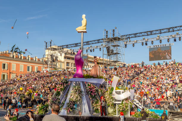 Carnaval de Nice, This years theme King of Fashion -  at the end of the flower parade the flowers are thrown to the spectators, thousands of fresh flowers every parade stock photo
