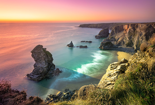 Sunset at Bedruthan Steps. Carnewas and Bedruthan Steps is a stretch of coastline located on the north Cornish coast between Padstow and Newquay, in Cornwall, England, United Kingdom