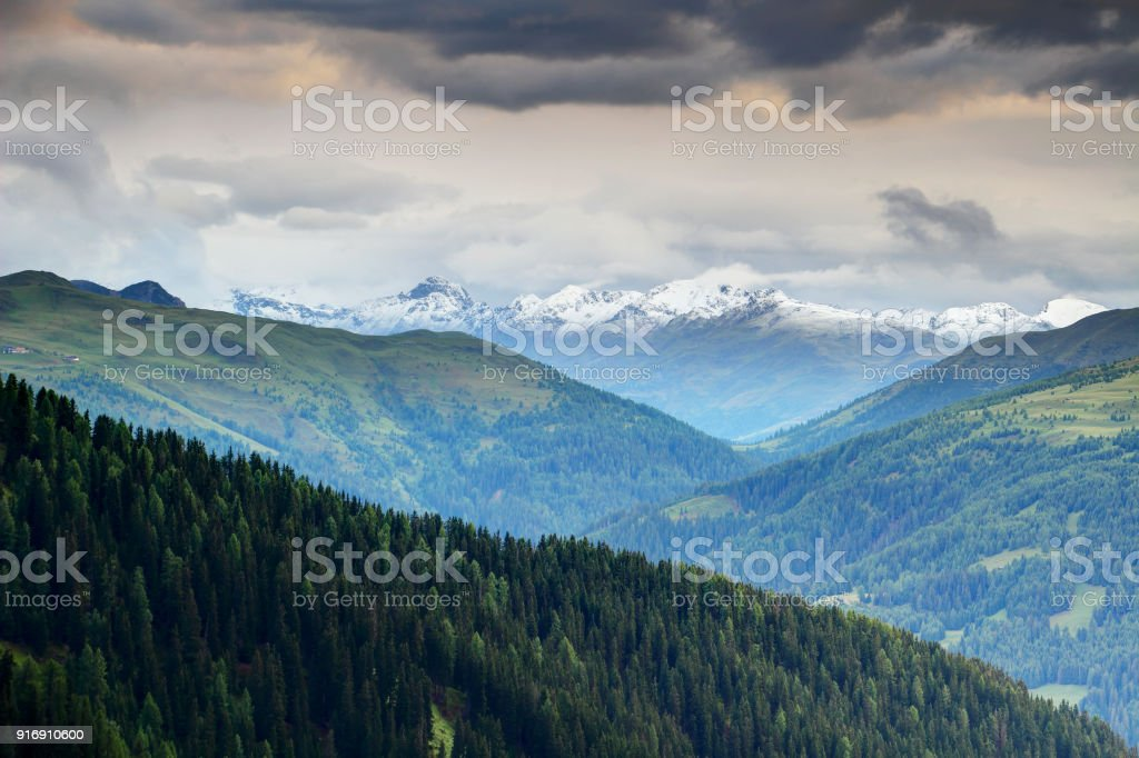 Carnic and Gailtal Alps pine forests and morning snow in Tauern stock photo
