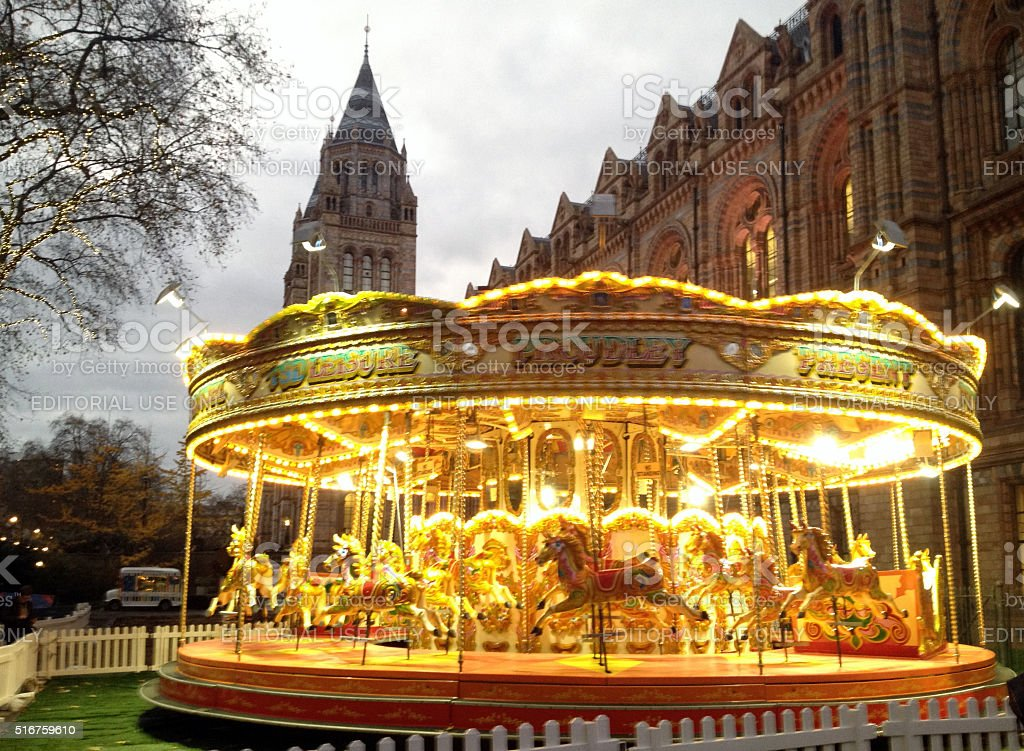 Carnival Carousel Merry-Go-Round outside of National History Museum London stock photo