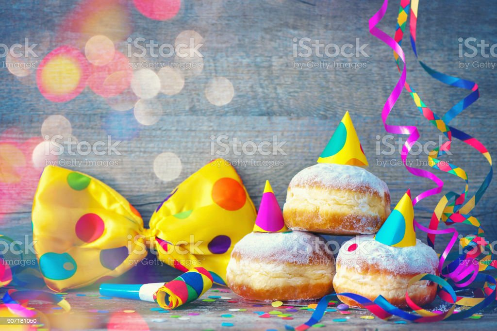 Carnival donuts with paper streamers and party bow tie stock photo