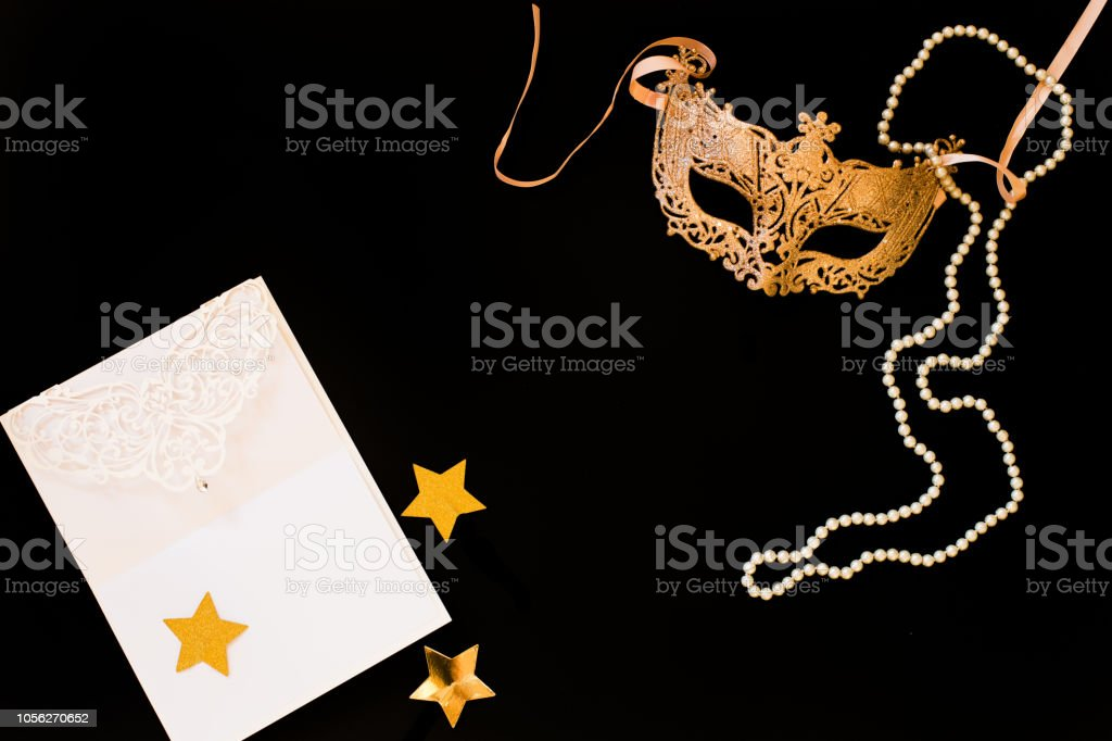 carnival, golden mask on a black background. ball, fun. stock photo