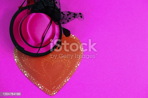 1135969446 istock photo Carnival hats on a pink background 1204784193