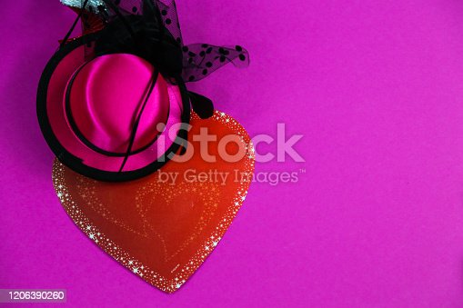 1135969446 istock photo Carnival hats on a pink background 1206390260