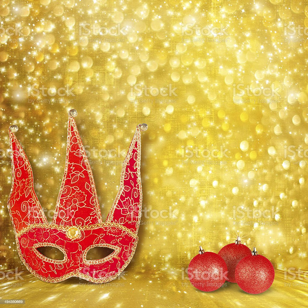 Carnival mask and a red Christmas ball royalty-free stock photo