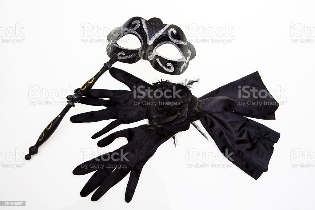 Carnival mask and black gloves stock photo