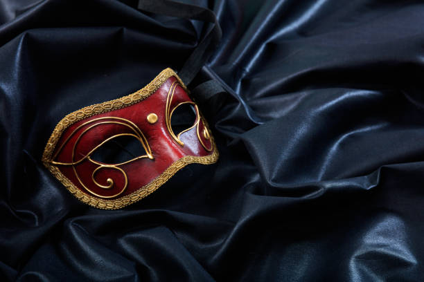 carnival mask isolated on black satin background - opera stock photos and pictures
