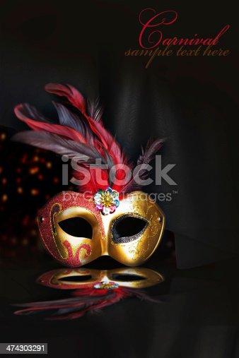 474303291 istock photo Carnival mask on black silk background 474303291