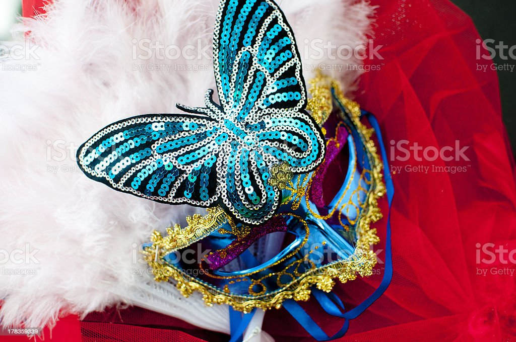 Carnival mask with blue sequins and feathers stock photo