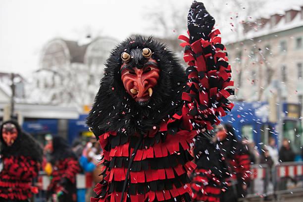 carnival party in freiburg - fasnacht stock-fotos und bilder