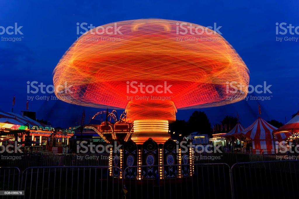 Carnival ride at the fair at dark stock photo