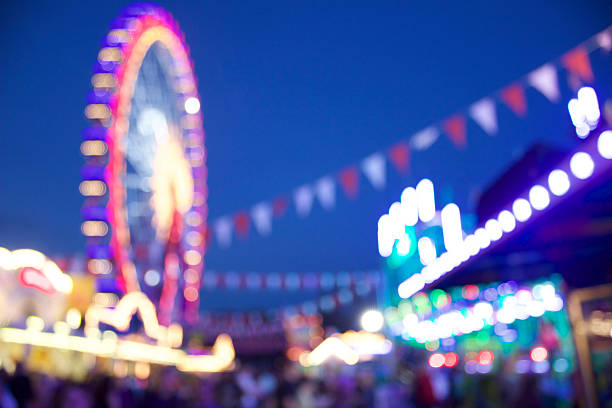 Carnival Scene Here you can see a defocused carnival scene with a ferris wheel in the backround ferris wheel stock pictures, royalty-free photos & images