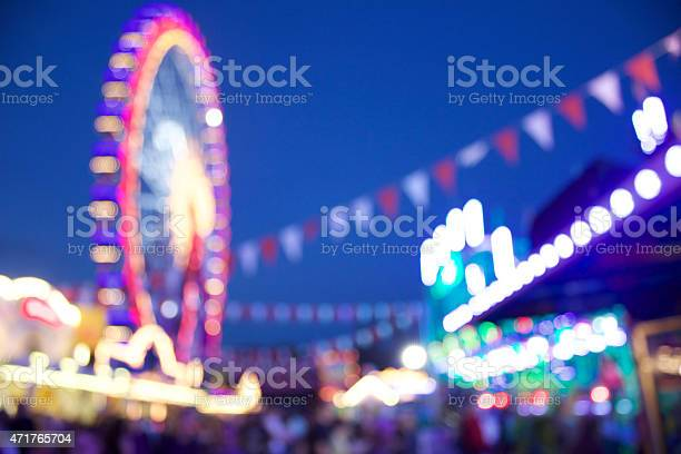 Here you can see a defocused carnival scene with a ferris wheel in the backround