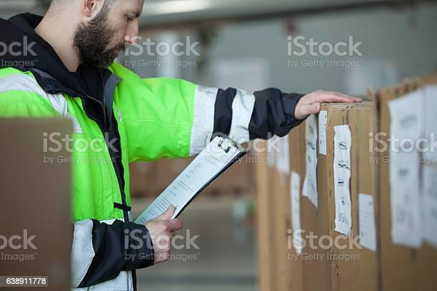 Caro Men Checking Parcels Stock Photo - Download Image Now