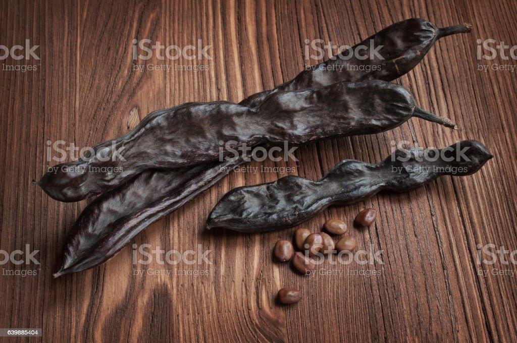 Carob pods and seeds stock photo