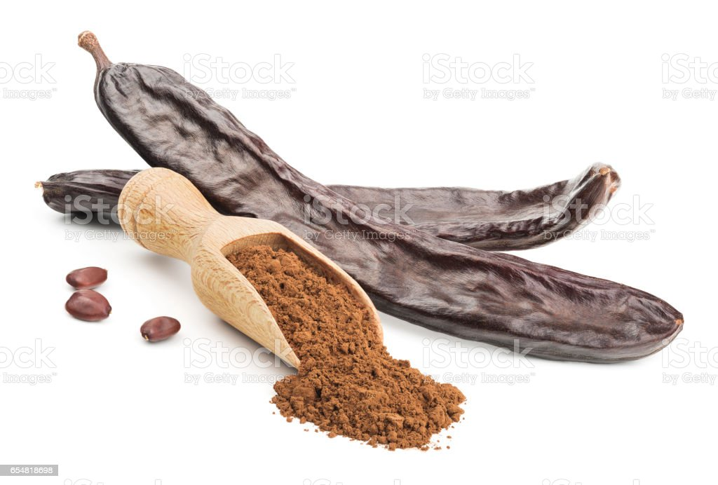 Carob powder and pods isolated on white stock photo