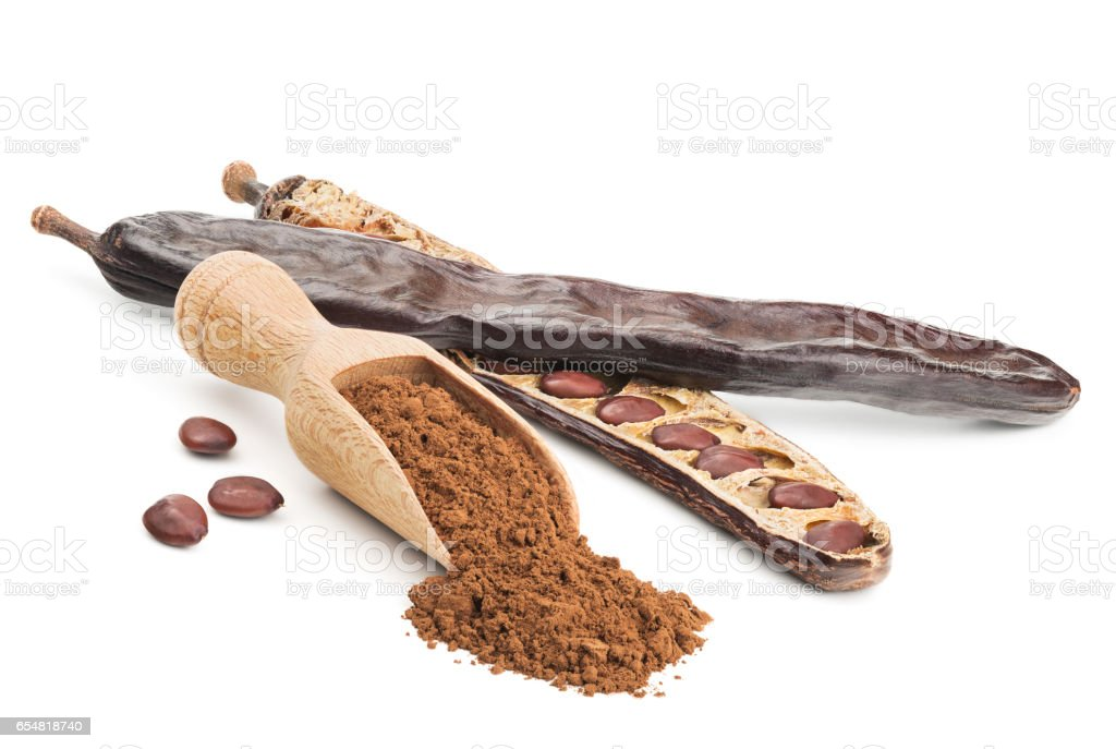 Carob powder and pods isolated on white - foto de stock